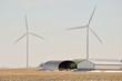 Indiana Wind Turbine over farm equipment