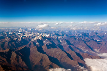 view from the aircraft to the high mountains of the Himalaya