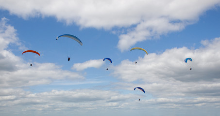 Paragliders soaring high in the sky