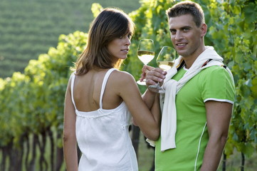 Couple in vineyard with white wine