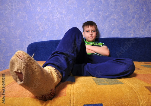 Boy wearing  socks with holes in them