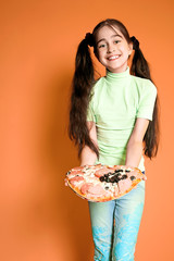 Pretty smiling girl with pizza