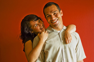 Young Attractive Couple Relationship Smiling in Love Hugging
