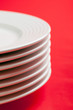 white plate on red background