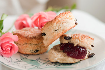 Traditional english scones with jam on the plate