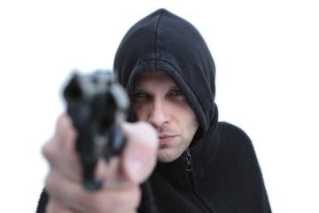 Hooded man pointing a gun