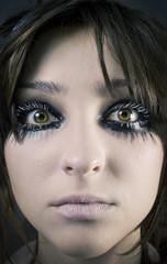 woman's face close up, big eyes and eyelashes.