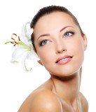 Fototapety Beautiful woman face with a flower