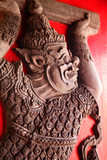 Mythical creature relief on temple door poster