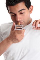 Man smelling perfume