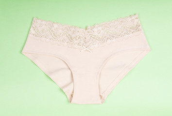 Beige Cotton Panties on Green Background