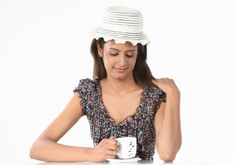 woman with cup of coffee relaxing happily
