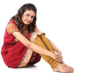 Indian girl sitting on the floor