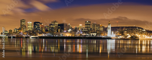 downtown skyline panorama  at dusk in Montreal Canada with river - 20790607