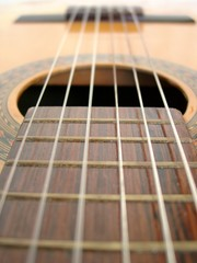 Frets, sound hole and bridge of an spanish guitar