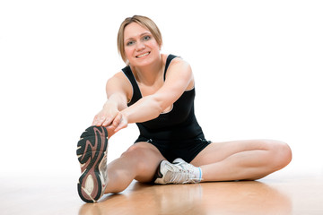 woman doing stretching exercise at the gym
