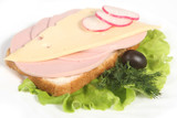 Ham sandwich with cheese, olives, radish and greenery poster