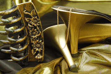 golden woman shoes and accessories on golden background