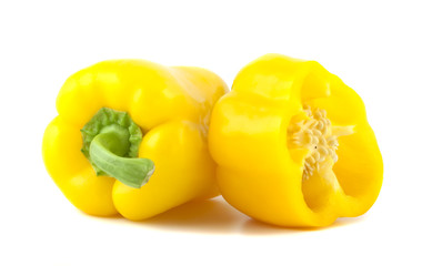 Yellow bell peppers isolated on white background.