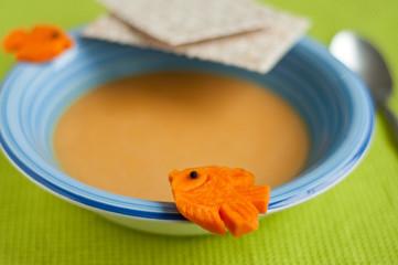 Pumpkin soup decorated with pumpkin fish