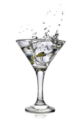 martini with olives and splash isolated on white