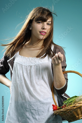 spring girl with basket celebrating holidays