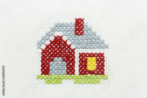Embroidery of the image of a small house