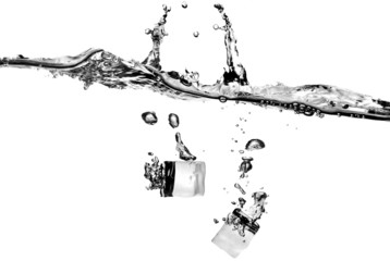 ice cubes dropped into water with splash isolated on white