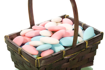 Couple of colorful Easter Almonds in a basket