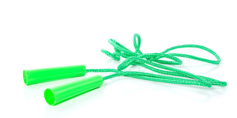 a green skipping rope isolated over white