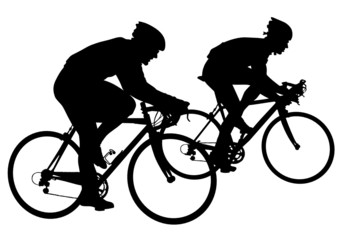 Two cyclists in motion