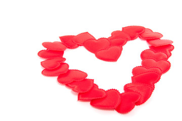 a big red heart made of many little hearts isolated over white