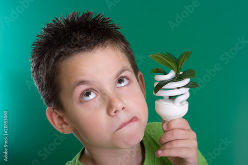 Kid with energy saving bulb