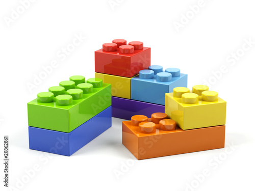 Plastic toy blocks on white background.
