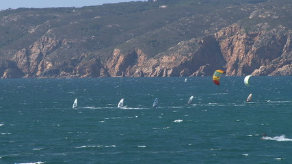 Kitesurfers in action on beach