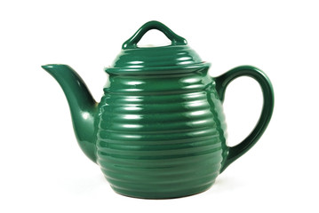 Green teapot isolated on white background