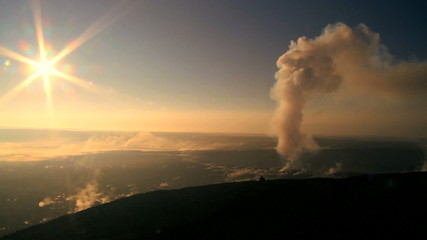 Sunset With Steam from a Volcanic Crater