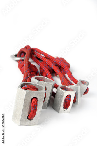 Rock climbing equipment on white background