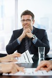Confident businessman at meeting