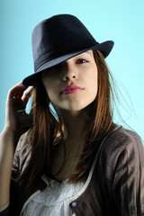 girl posing with black hat