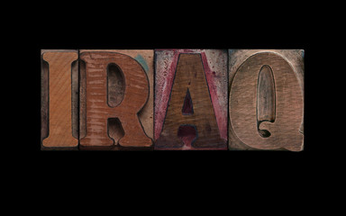 the word Iraq in old letterpress wood type
