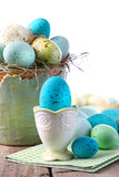 Easter scene with turquoise speckled egg in cup poster