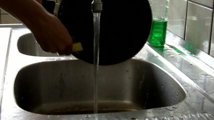 Woman washing pan