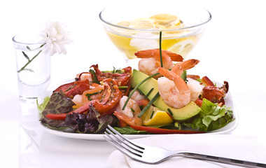 Prawn salad on mixed greens and sun dried tomatoes.