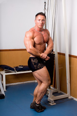 Bodybuilder posing -flexing his bicep