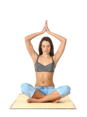Young fit brunette meditating