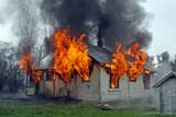 house on fire, flames out windows, smoke