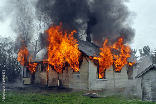 house on fire, flames out windows, smoke - 20903474