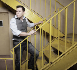 Man on a yellow staircase