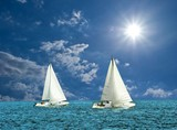 two white sail boats in a sea poster